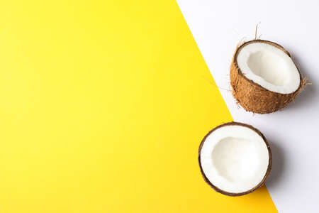 Coconut halves on two tone background, space for text