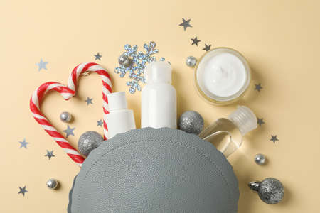 Set of cosmetics, jar of winter cream for skin on yellow background, space for text. Top view
