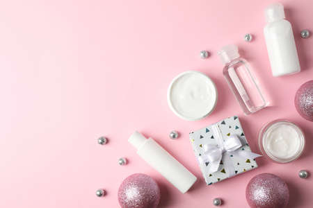 Set cosmetics, jar of winter cream for skin on pink background, space for text. Top view Stock Photo