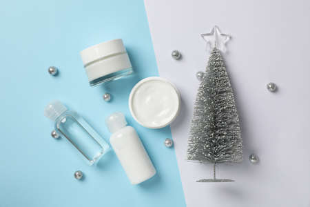 Set cosmetics, jar of winter cream for skin on two tone background, space for text. Top view Stock Photo