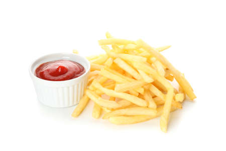 Stack of tasty french fries, red sauce isolated on white background
