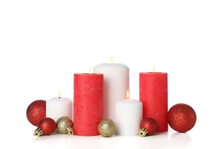 Candles and Christmas balls isolated on white background