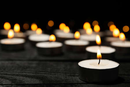 Group of burning candles on black background, close up Zdjęcie Seryjne