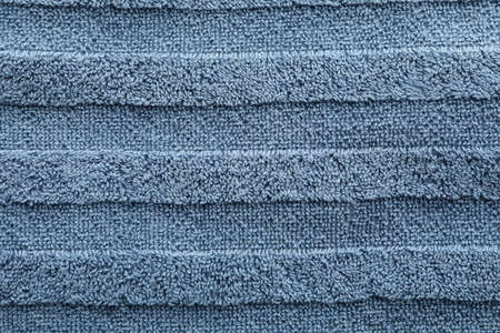 Blue towel textured background, closeup and space for text