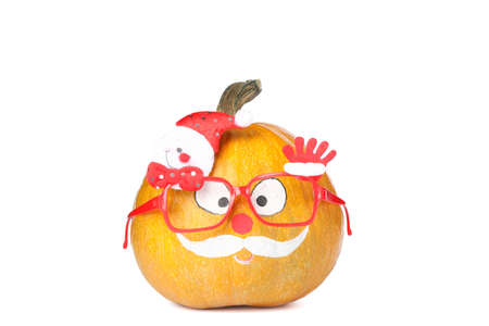 Pumpkin with mustache and red glasses isolated on white background