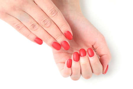 Woman hands, stylish red manicure isolated on white background, top view. Healthcare concept