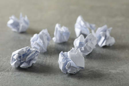 Paper balls on grey table, space for text