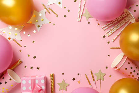 Composition with different birthday accessories on pink background, space for text Stock Photo