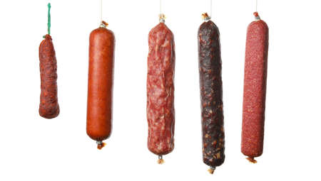 Different hanging sausages isolated on white background