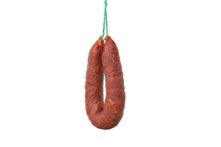 Delicious hanging sausage isolated on white background