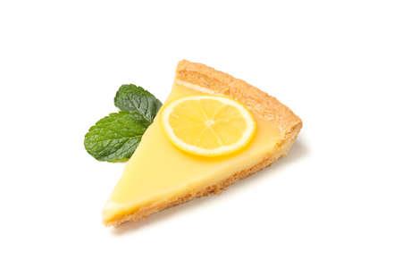 Lemon tart slice and mint isolated on white background