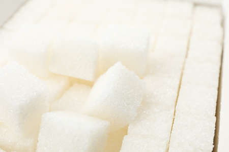 White sugar cubes texture background, close up