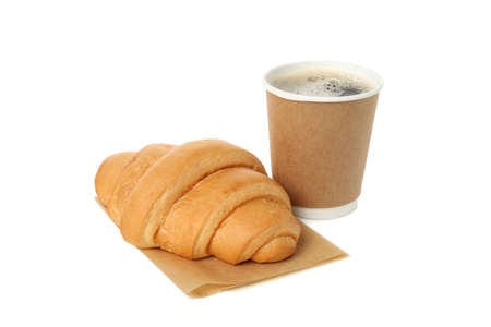 Cup of coffee and baking paper with croissant isolated on white background