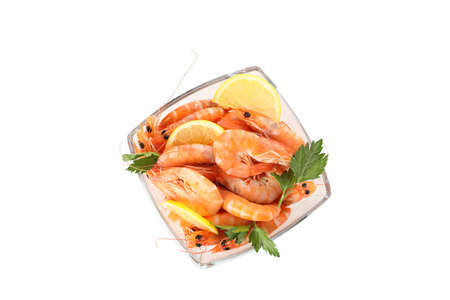 Square bowl with shrimps, parsley and lemon isolated on white background