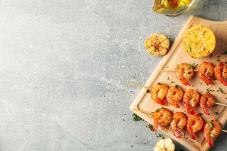 Composition with delicious shrimps on grey background, top view