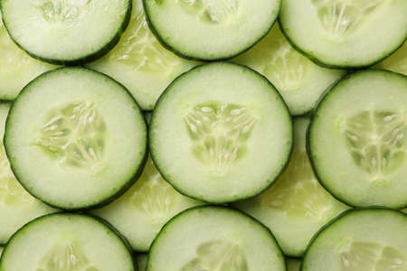 Fresh cucumber slices texture background, close up