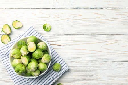 Bowl with brussels sprout on wooden background, top view 版權商用圖片