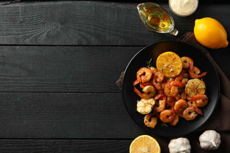 Composition with delicious shrimps on wooden background, top view