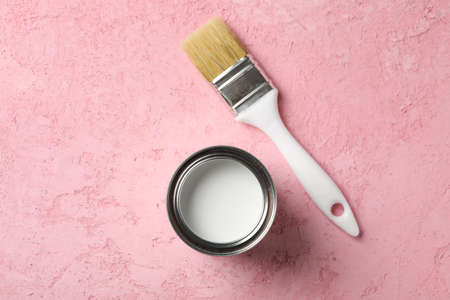 Paint can and brush on pink background, top view Stock Photo
