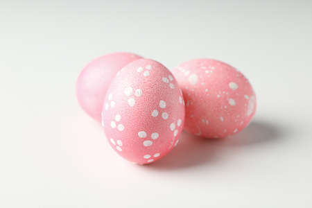 Pink easter eggs on white background, close up