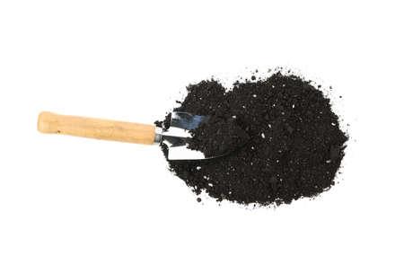 Fertile soil and shovel isolated on white background