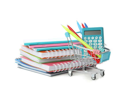 Shop trolley with stationery and copybooks  isolated on white background