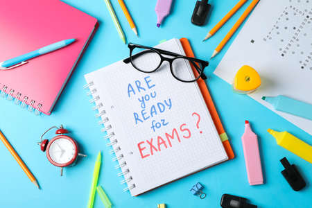 Inscription Are you ready for exams and stationary on blue background, top view Zdjęcie Seryjne