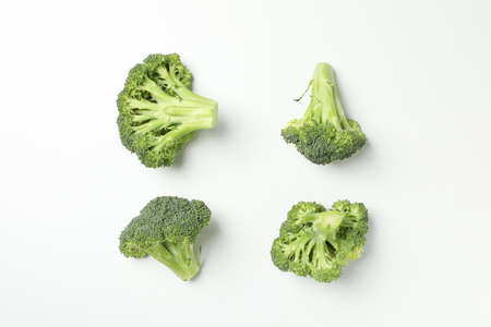 Flat lay with broccoli on white background, top view