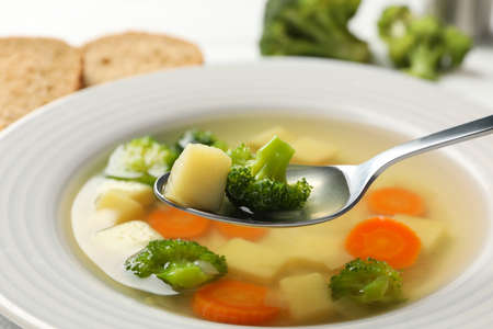 Spoon with potato and broccoli. Vegetable soup