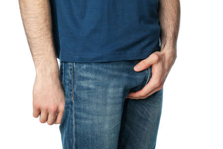 Man holding his groin, isolated on white background. Men's health Stockfoto