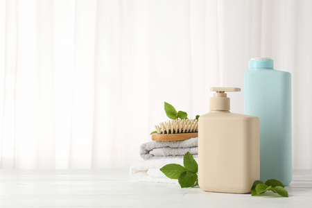 Composition with hair care products on wood table