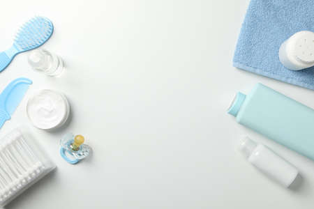 Baby hygiene accessories on white background, top view and space for text
