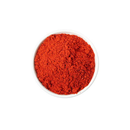 Bowl of pepper powder spice isolated on white background