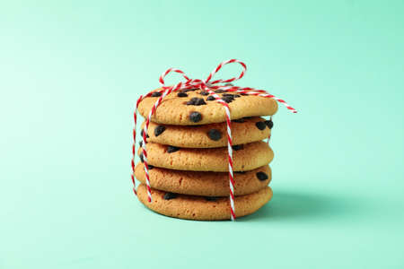 Pile of chocolate chip cookies on mint background