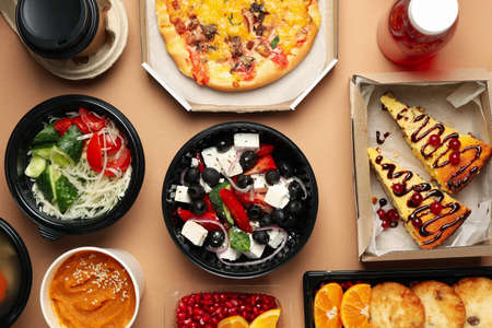 Food delivery. Food in takeaway boxes on craft background