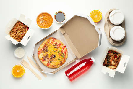 Food delivery. Food in take away boxes on white background Foto de archivo