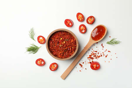 Composition with chilli pepper, spice and sauce on white background Zdjęcie Seryjne