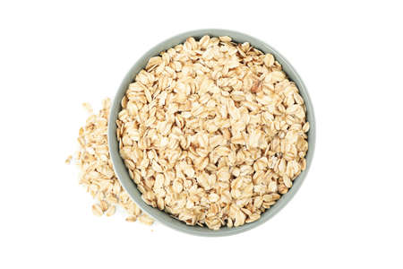 Bowl with oatmeal flakes isolated on white background