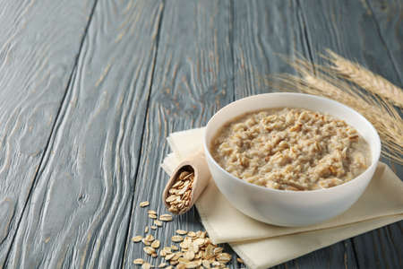 Composition with oatmeal porridge on wooden background. Cooking breakfast Stock Photo