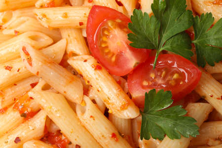 Tasty pasta with tomato and parsley on whole background, close up
