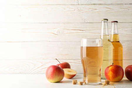 Composition with cider, sugar and apples on white wooden background Standard-Bild