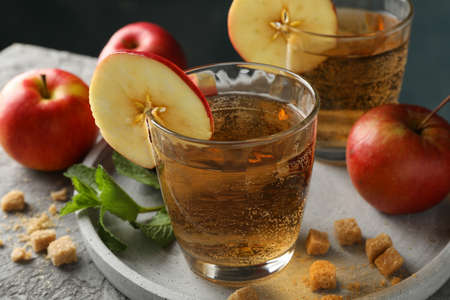 Composition with cider, sugar and apples on gray table Standard-Bild