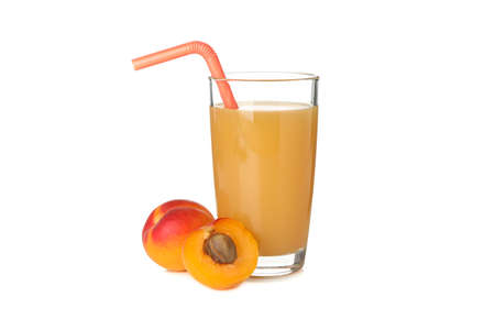Glass with juice and apricots isolated on white background