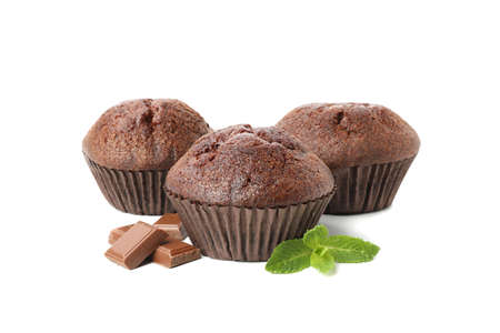 Delicious chocolate and muffins isolated on white background