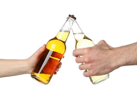Hands hold bottles of cider, isolated on white background. Cheers