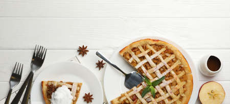 Composition with apple pie on white wooden background. Tasty lunch. Homemade breakfast