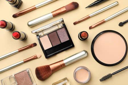 Different makeup cosmetics on beige background. Female accessories Archivio Fotografico