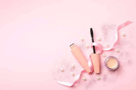 Composition with mascara on pink background. Female accessories