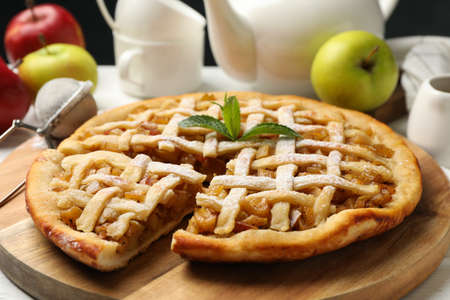 Tasty apple pie on white wooden background, close up. Homemade food