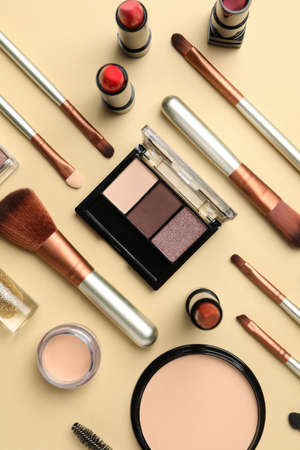 Different makeup cosmetics on beige background. Female accessories